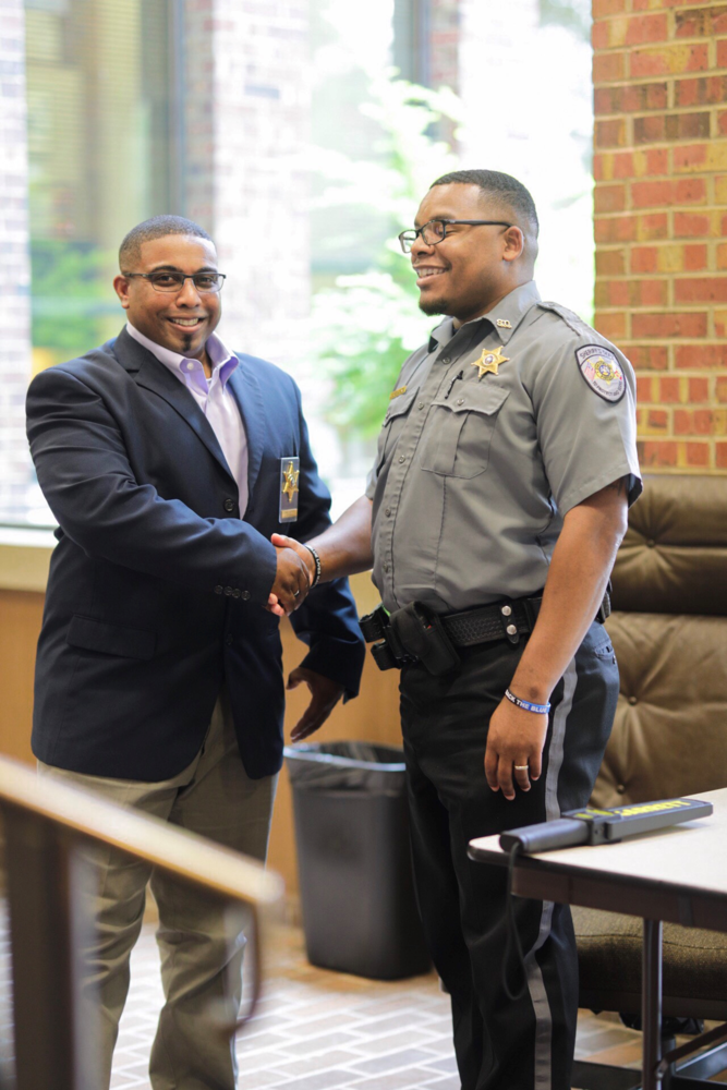 Major Mitchell shaking hands with another officer